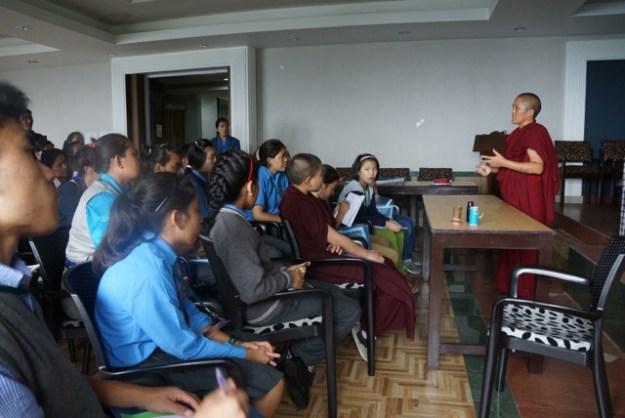 Tibetan nun giving lecture
