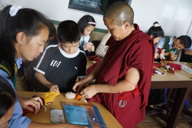 Tibetan Buddhist nun at workshop for students