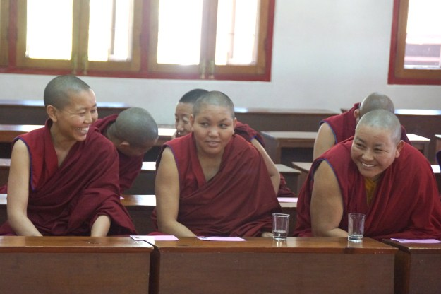 Three senior nuns awaiting their turns to debate during the 2014 Geshema examinations