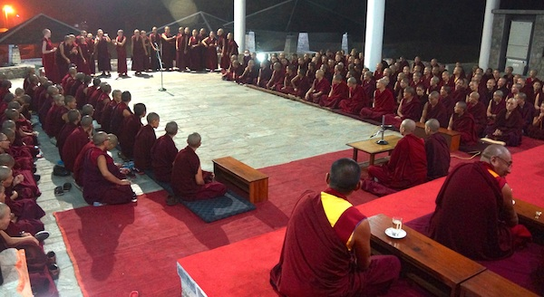 Buddhist nuns debating in front of their teachers