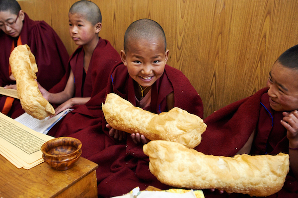 young Buddhist nuns with Losar cookie