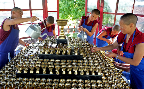 Buddhist nuns preparing butter lamps