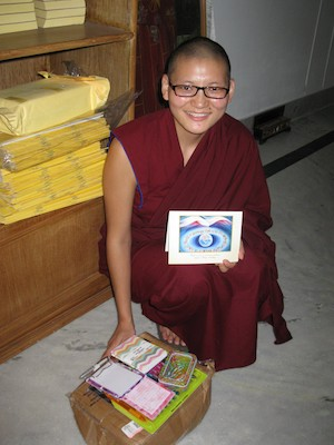 Sakya nun with a gift from her sponsor