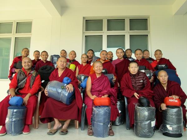 Sakya nuns with gifts of sleeping bags
