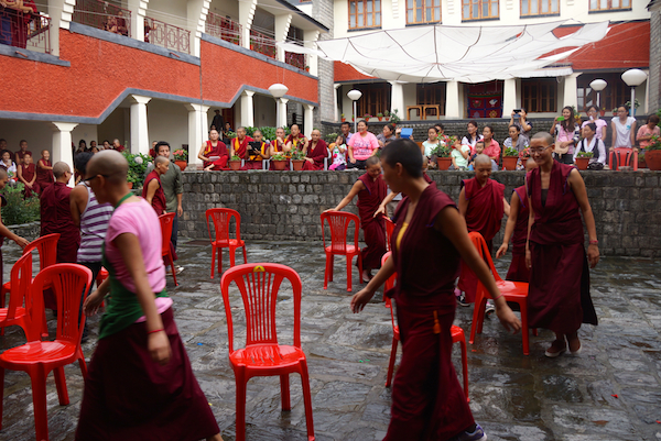 Tibetan Buddhist nuns playing musical chairs