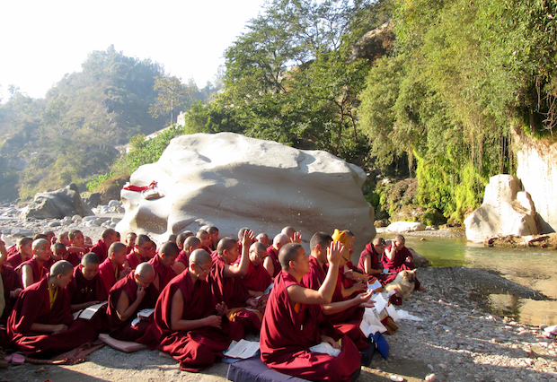 Buddhist nuns worship near cave of Tilopa