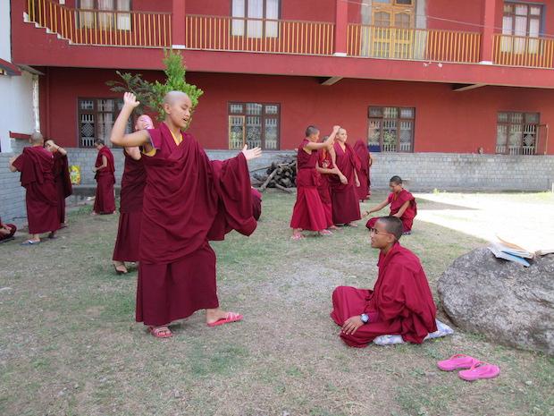 Tibetan Buddhist nuns debating outside the nunnery