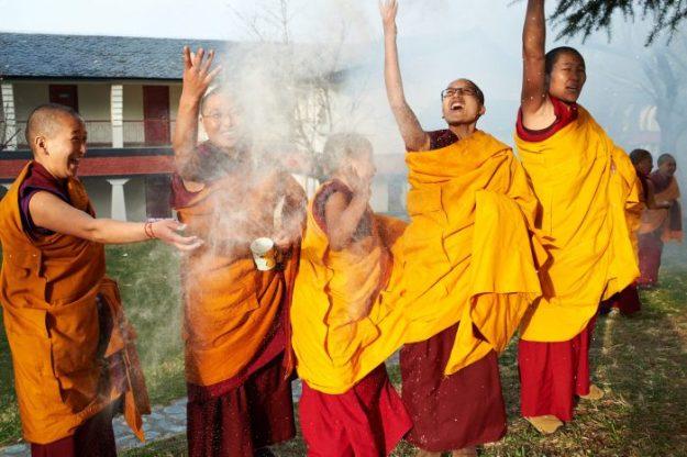 Tibetan Nuns Project, Tibetan Buddhist nuns, Tibetan Buddhist holidays, tsampa, throwing tsampa, Olivier Adam