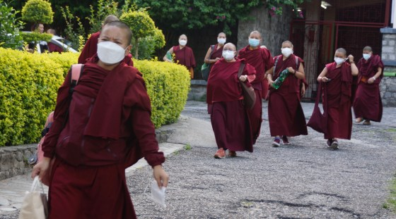 Tibetan nuns at Dolma Ling leaving to get vaccinated
