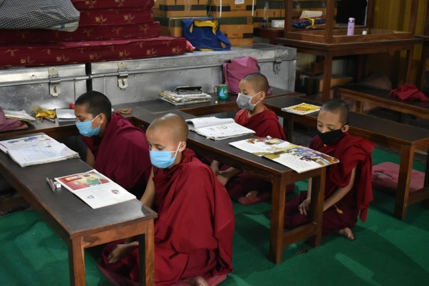 Tibetan Buddhist nuns wearing masks