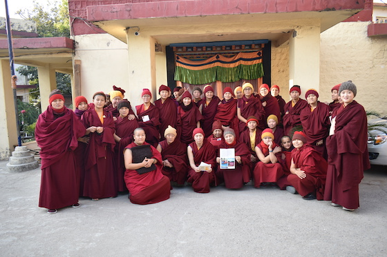 Tibetan Buddhist nuns at Tilokpur Nunnery receiving wool items from Wool-Aid