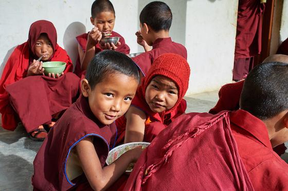 young Tibetan Buddhist nuns at Sherab Choeling Nunnery eating