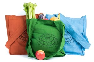 Shopping bag is made of cotton, reusable and eco-friendly with Tibetan Nuns Project screenprint on both sides.