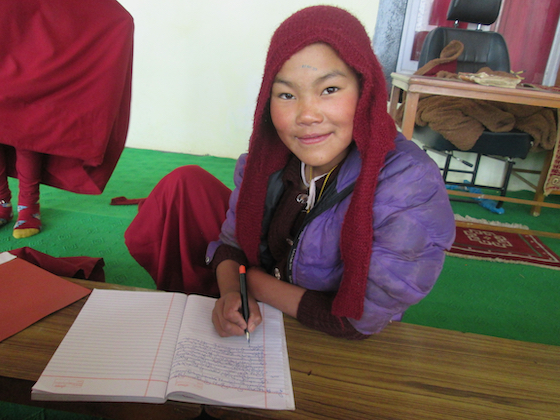 Tibetan Buddhist nun studying