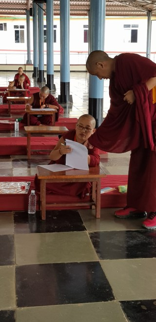 Tibetan Buddhist nun taking Geshema exams August 2019