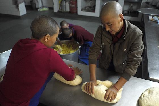 kneading dough, making Tibetan bread