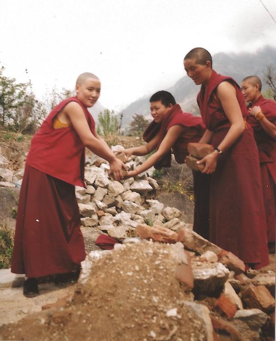 Tibetan Buddhist nuns helping to build Dolma Ling Nunnery
