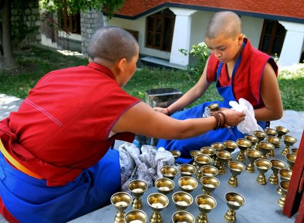 butter lamps, pujas, Tibetan nuns