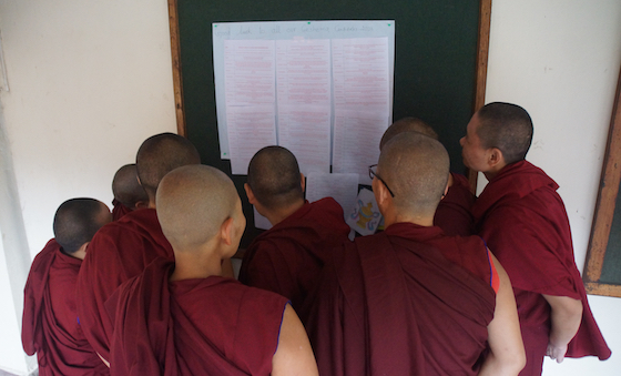 Tibetan Buddhist nuns read good luck messages Geshema exams