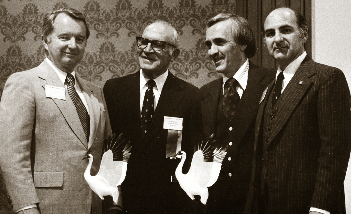 """Clark Akers, Dr. Greer Ricketson, Tony Campbell and Dr. Edward Thackston pose for pictures during the National Wildlife Federation's 1980 annual convention in Miami. Akers received one of the whooping crane statuettes for his success in stopping the West Tennessee Tributaries Project. Thackston accepted the other """"Connie"""" for the Tennessee Conservation League as outstanding NWF affiliate for 1979."""