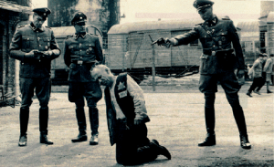 German officers shooting Jewish prisoner during World War II