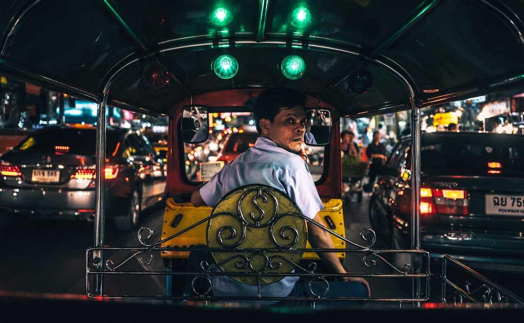 Common Thailand scams: fix price before Tuk-Tuk ride. Image of tuk-tuk in Bangkok