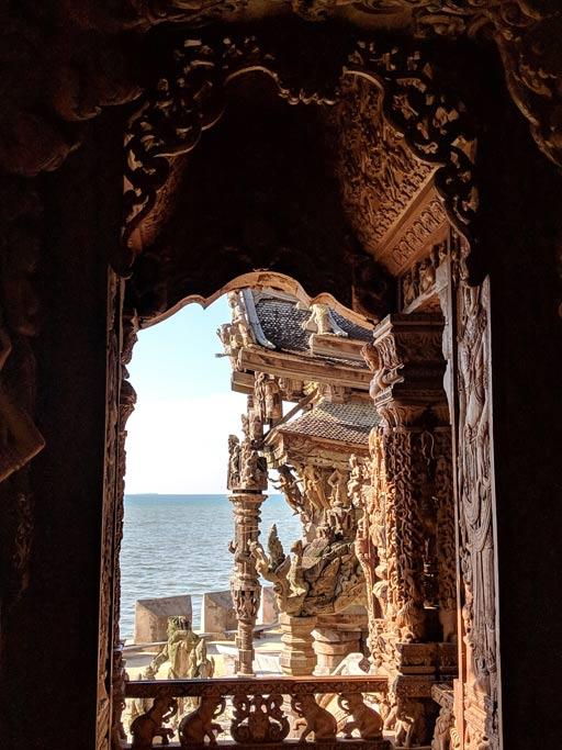 View of sea through wooden door in Sanctuary of Truth