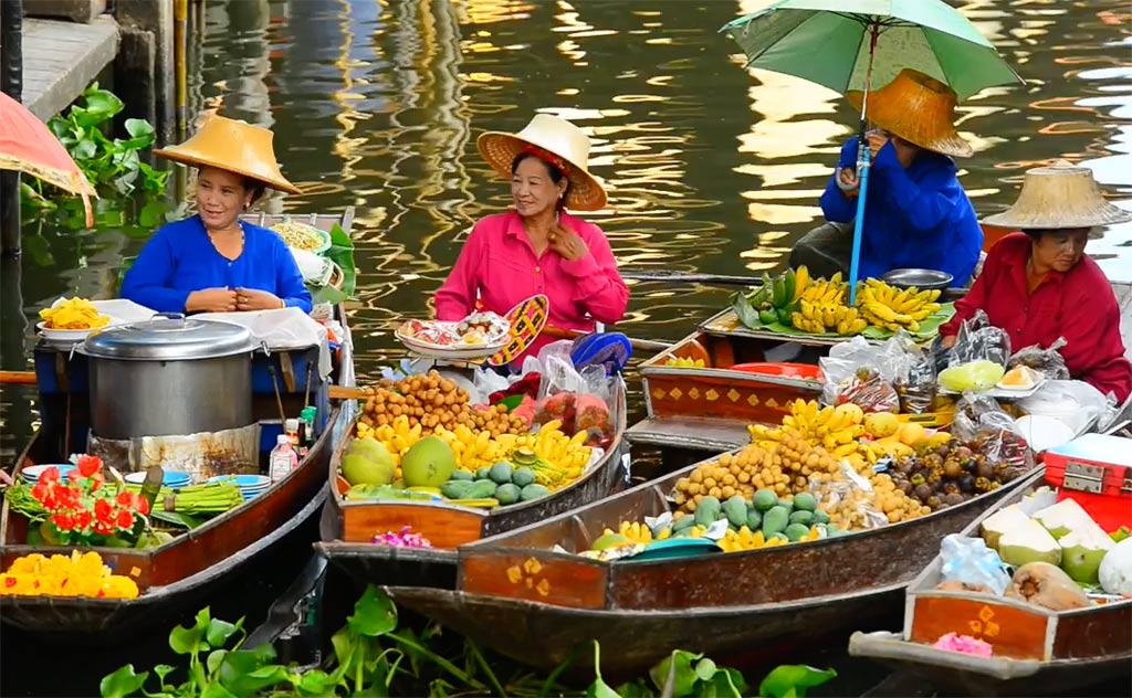 Fruits of Thailand. Women selling exotic Thai fruits in Bangkok's floating market