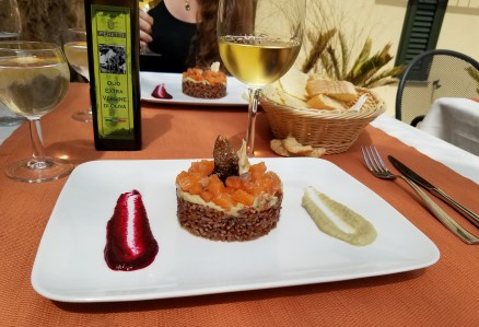 La Cullera's salmon tartare accompanied by brown rice and an artichoke and red beet puree.