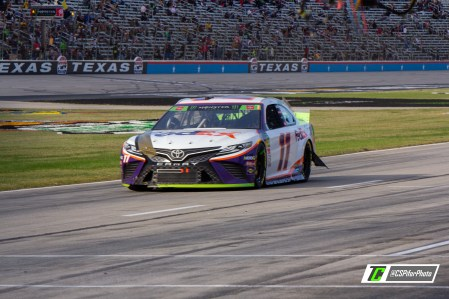 Denny Hamlin's car suffered severe damage after sliding through the grass near the end of Stage 1. Photo Credit: Caleb Pifer / TobyChristie.com