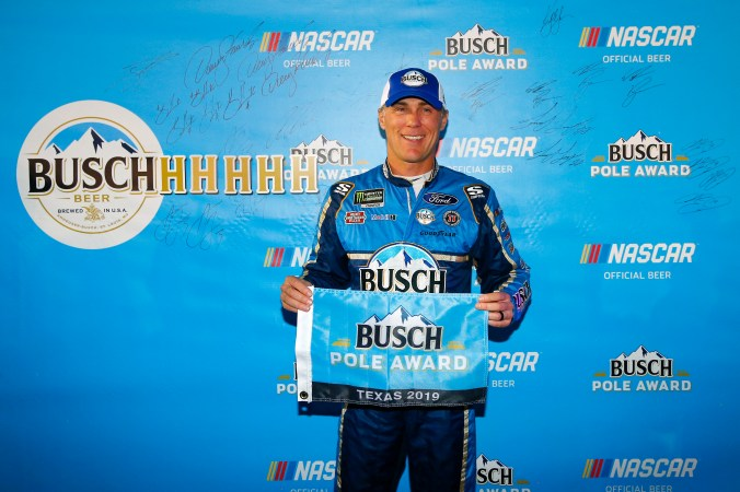 FORT WORTH, TEXAS - NOVEMBER 02: Kevin Harvick, driver of the #4 Busch Beer/Ducks Unlimited Ford, poses with the Pole Award after posting the quickest lap during the Salute to Veterans Qualifying Day Fueled by The Texas Lottery for the Monster Energy NASCAR Cup Series AAA Texas 500 at Texas Motor Speedway on November 02, 2019 in Fort Worth, Texas. (Photo by Jonathan Ferrey/Getty Images)