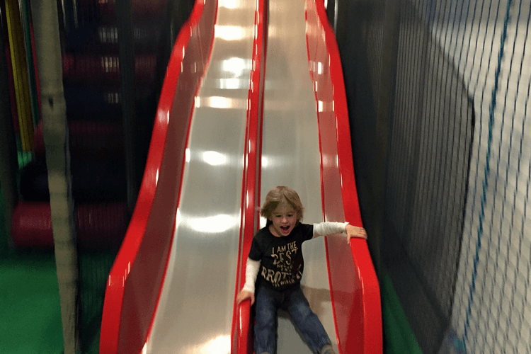 So much confidence flying down the big slide at soft play