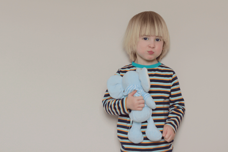 Toby's cheeky face in Maxomorra striped top