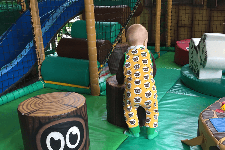Gabe exploring soft play in his sheep dungarees