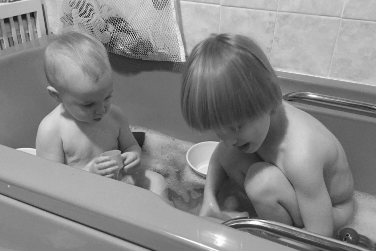 Toby and Gabe playing in the bath together