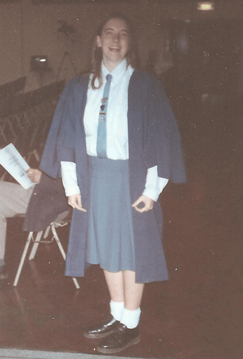 Me in my school uniform and gown as head girl