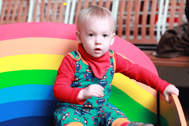 Gabe ready to listen on the rainbow bench