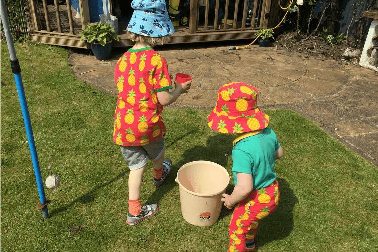 Playing in Grandma and Grandad's garden in Maxomorra pineapples
