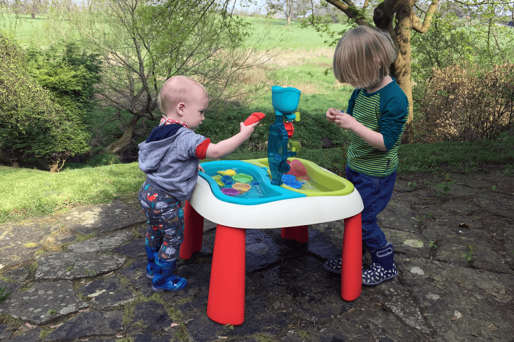 Toby and Gabe playing at the water table together