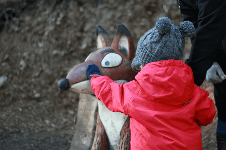 Gabe stroking Fox on the Gruffalo trail