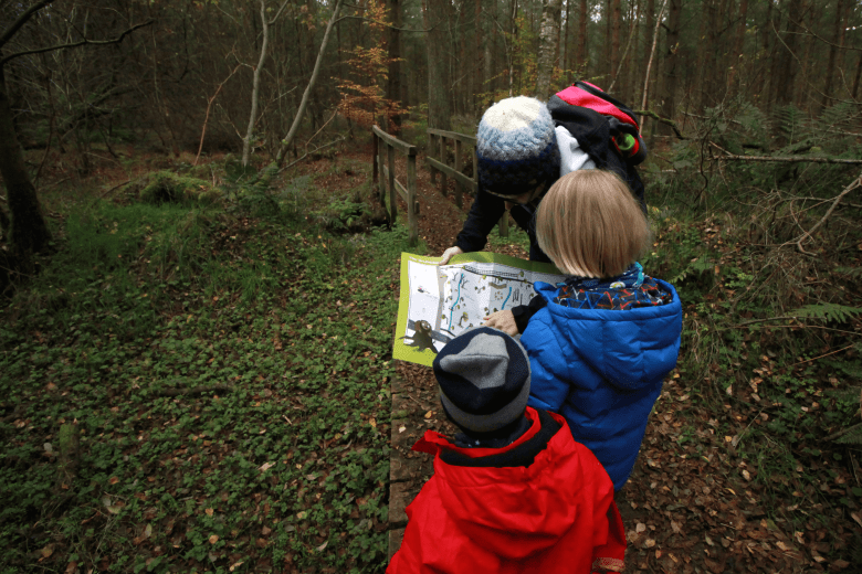 Toby and Gabe looking at the map at Cliburn Moss near Penrith