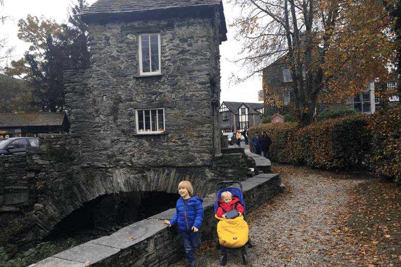 oby and Gabe outside The Bridge House in Ambleside