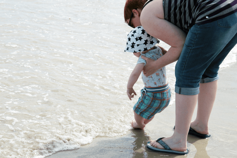 Dipping toes in the sea in France - great holiday destination with kids
