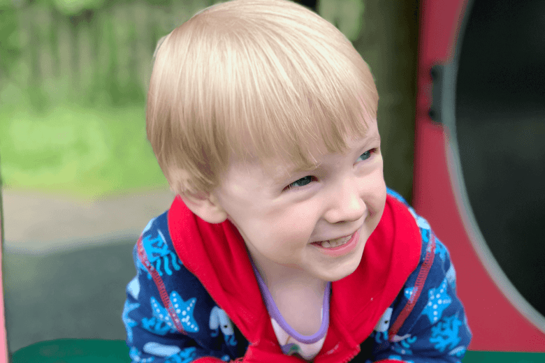 Gabe smiling in the play area at the garden centre