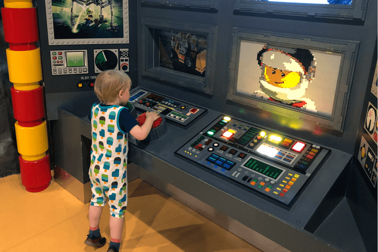 Gabe playing with Mission Control at LEGOLAND Discovery Manchester
