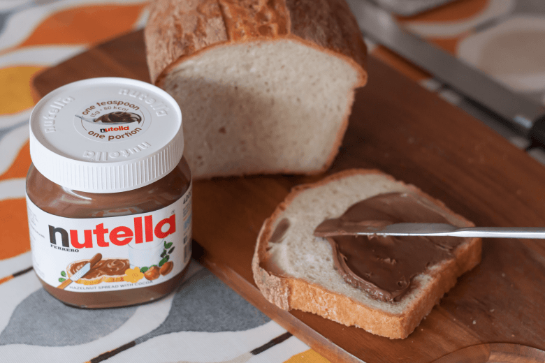 Fresh bread with one portion of Nutella