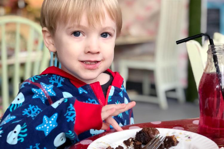 Gabe enjoying a chocolate brownie