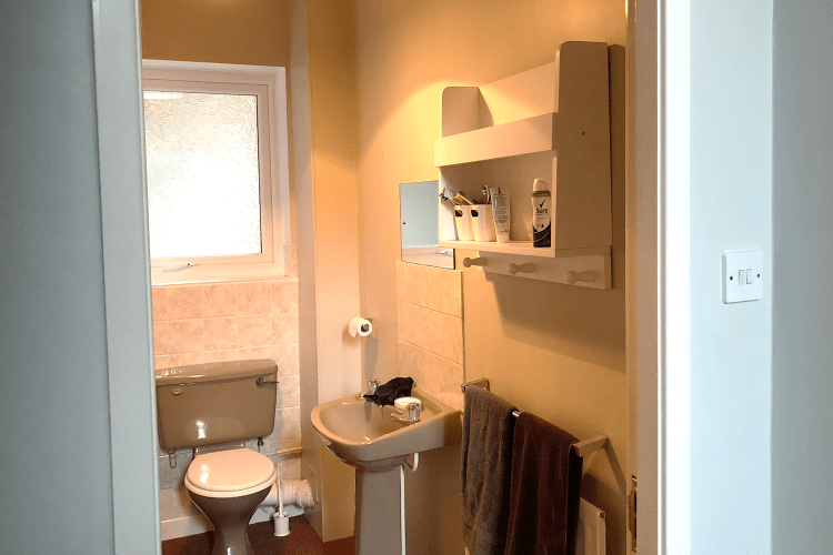 Sink and toilet in old bathroom