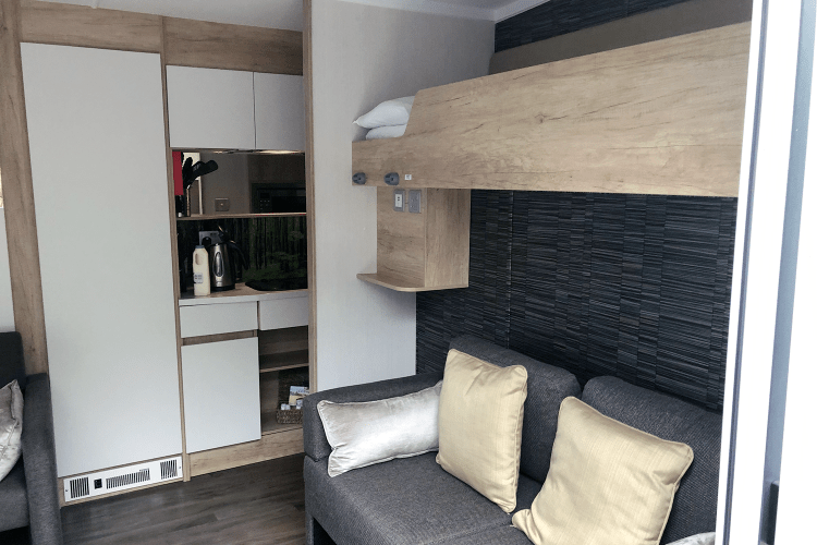 Bunk and sofa bed in the glamping pod from the Caravan and Motorhome Club