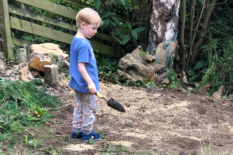Gabe digging in the garden